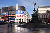 Piccadilly Circus and Statue of Eros on a wet winters day London
