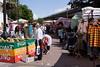 Clothes stalls and coconut milk stall Portobello Road Street Market July 2007