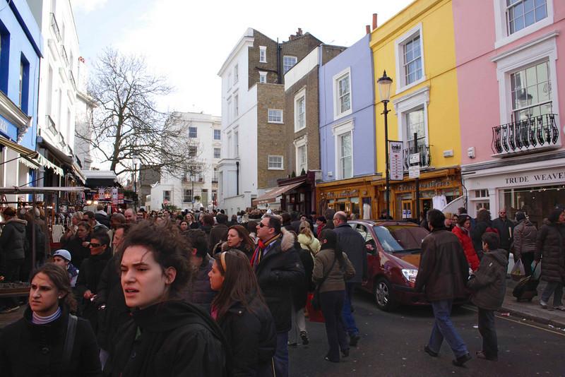 Crowd walking through Portobello Road London March 2008
