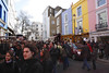Crowd walking through Portobello Road London March 2008