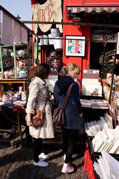 Shopping at Alice's antiques shop Portobello Road London