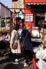 Shopping at Alice's antiques shop Portobello Road London