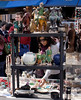 Woman shopping at antiques stall Portobello Market London