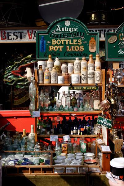 Antique collectable bottles outside Alice's Antiques Shop Portobello Road London