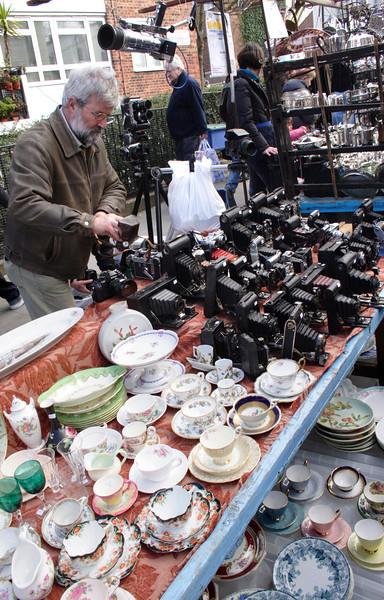 Antique camera and crockery stall Portobello Road London