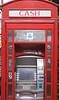 Cashpoint machine inside English ex telephone Box at Portobello Road London