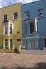 Colourful terraced houses off Portobello Road Notting Hill London