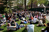 People and office workers relaxing at lunchtime Soho Square London April 2009