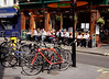 Cafe and parked bicycles Soho London April 2009