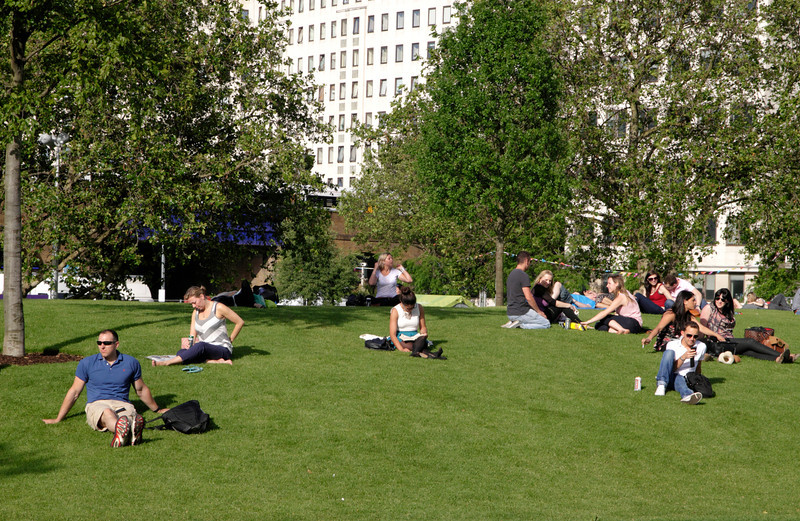People relaxing at Jubilee Gardens South Bank London