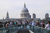 Crowd walking over Millenium Bridge London June 2012