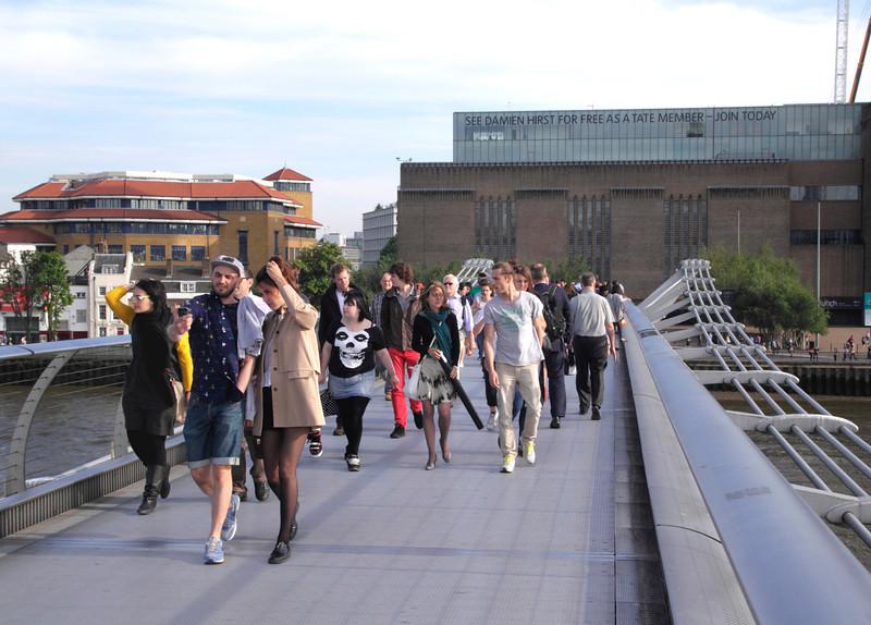 People walking over Millenium Bridge London June 2012