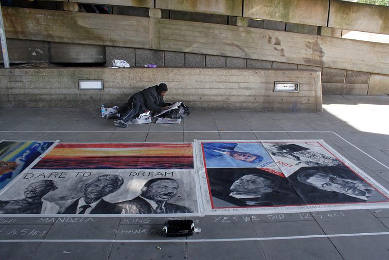 Street Artist under the Hungerford Bridge South Bank London September 2009