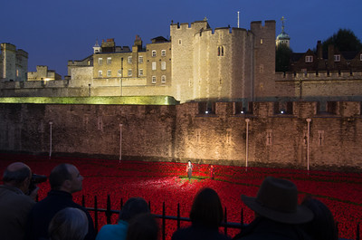 Over 800,000 ceramic poppies placed all around Tower of London.  Every night as sundown, names are read out in memory of soldiers killed in WW I