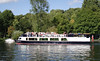 Boat cruising on River Thames at Henley Oxfordshire