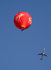 Virgin hot air balloon and Virgin airliner over Oxfordshire