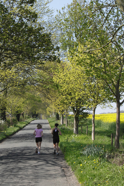 Joggers in country lane Shiplake Oxfordshire Spring 2010