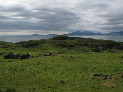 Rubh an Dunain - ruins of Clan MacAskill houses from 19th Century - Islands of Eigg & Rum in distance