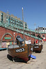 Boats displayed by Brighton fishing Museum at the seafront Brighton Sussex