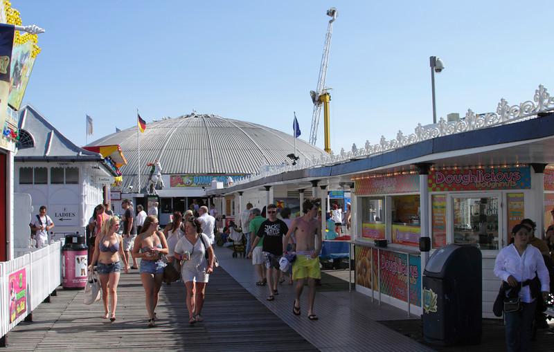 People walking on Brighton Pier Sussex