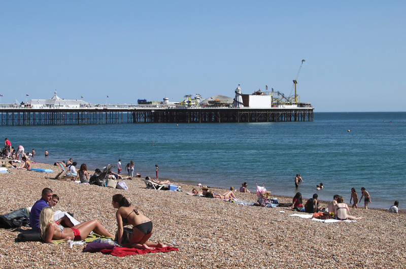 People sunbathing on Brighton Beach Sussex