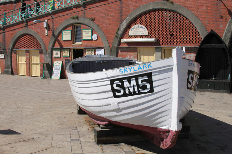 Boat displayed by Brighton fishing Museum at the seafront Brighton Sussex
