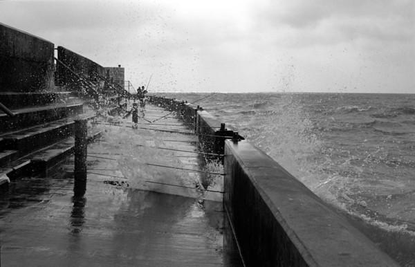 Breaking wave at sea wall Brighton