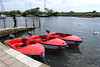 Red Motor boats at Christchurch Quay Dorset