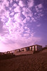 Beach huts at dusk South Coast Dorset