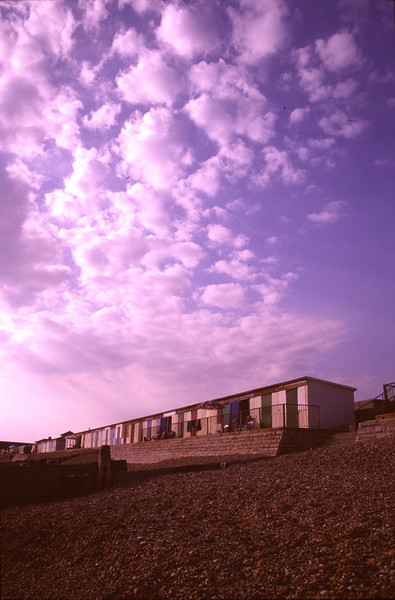 Beach huts at dusk South Coast Dorset