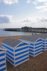 Beach huts and pier Hastings beach East Sussex