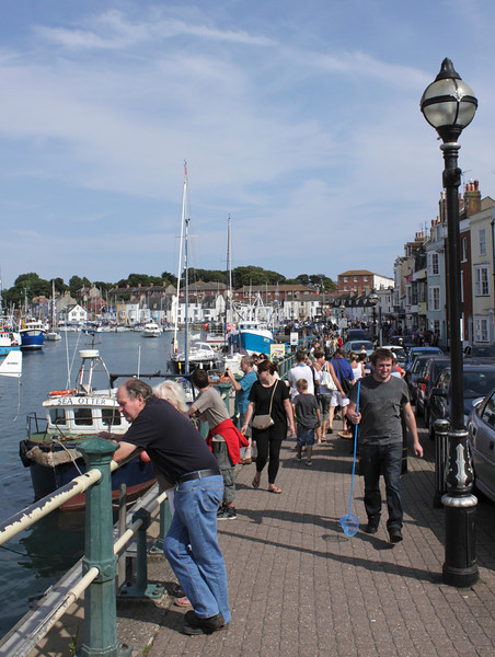 People walking along the quay at Weymouth Harbour summer 2010