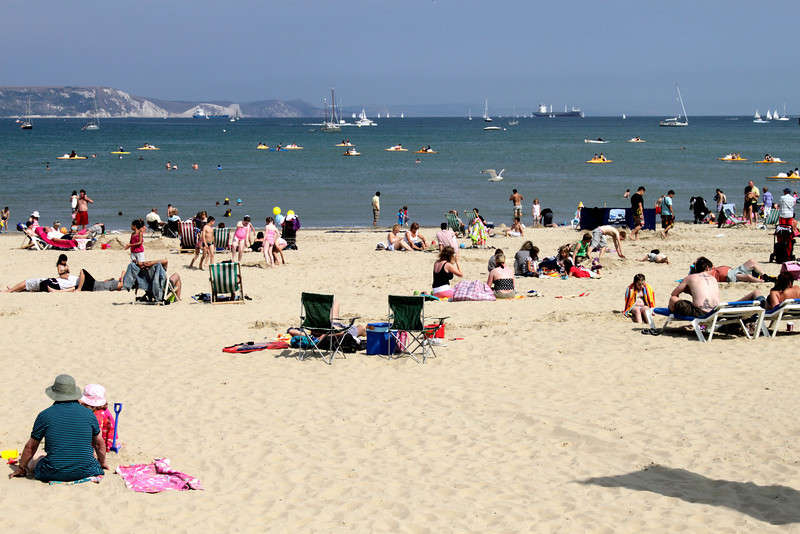 Sunbathers at Weymouth Beach Dorset summer 2010