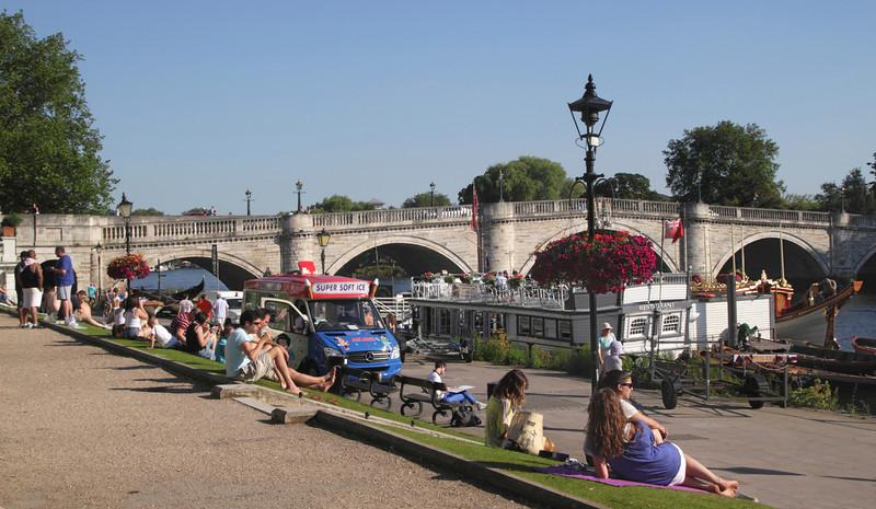 People relaxing near Richmond Bridge Surrey