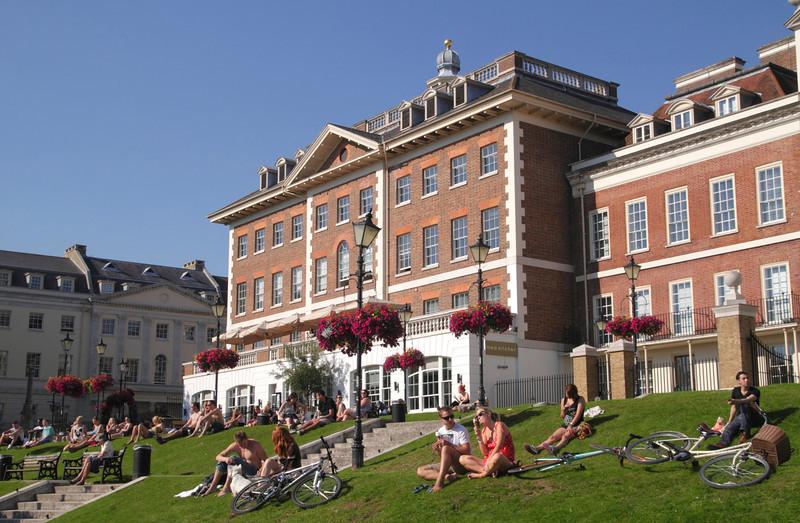 Sunbathers at riverside Richmond Upon Thames Surrey