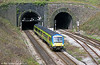 Central Trains 170516 emerges from Newport Tunnel with a service from the Midlands to Cardiff Central on 9th April 2002.