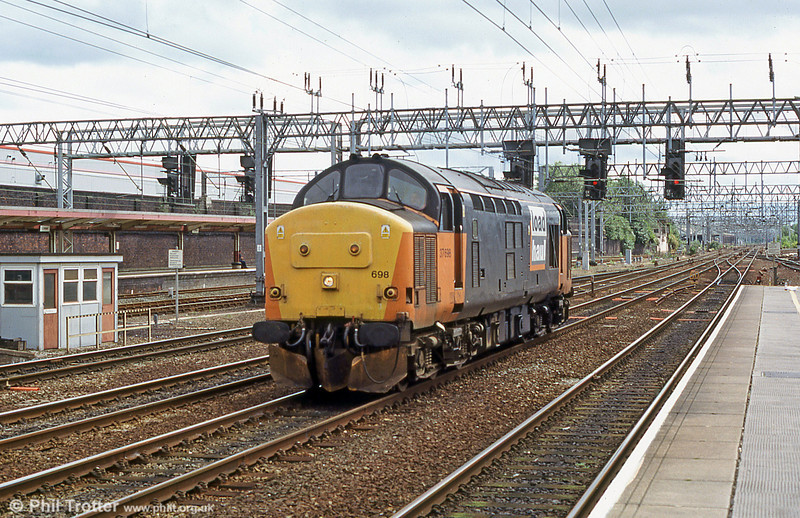 37698 - in Load Haul livery - rolls through Crewe in late 2003.