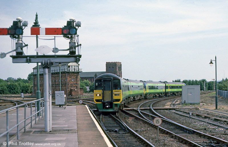 A Central Trains-liveried class 158 on a service from the Cambrian Coast approaching Shrewsbury,