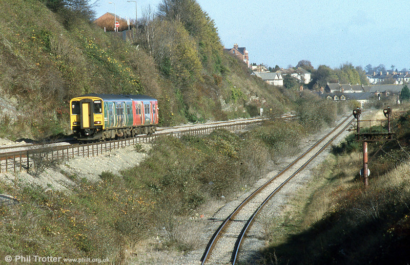Advertising liveried 150279 passes the Barry Docks Low Level Line at Cadoxton forming a service to Barry Island on 7th November 2002.