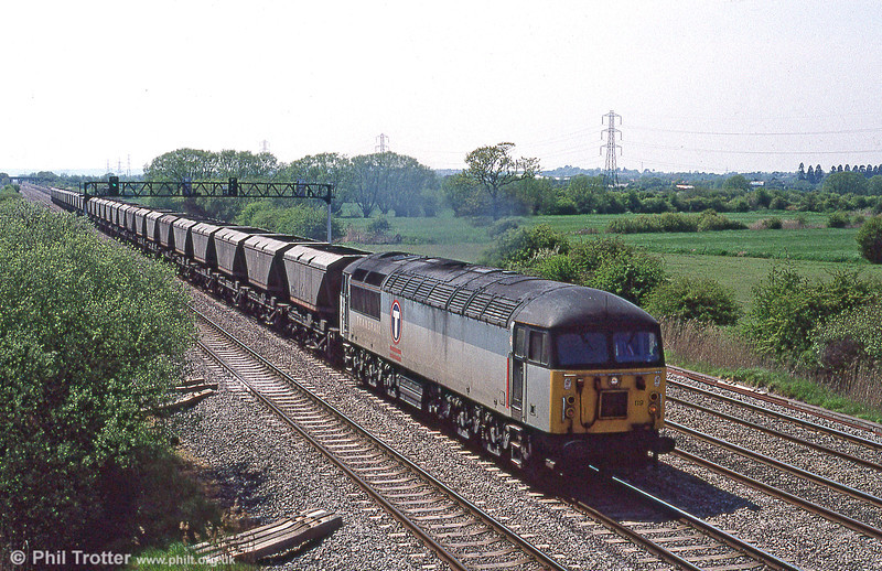 56119 passes Coedkernew with 6B54, 1425 Margam to Llanwern mgr on 13th May 1996.
