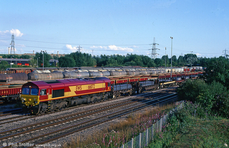 66072 is seen at Newport ADJ with steel slabs for Llanwern on 7th August 1999.