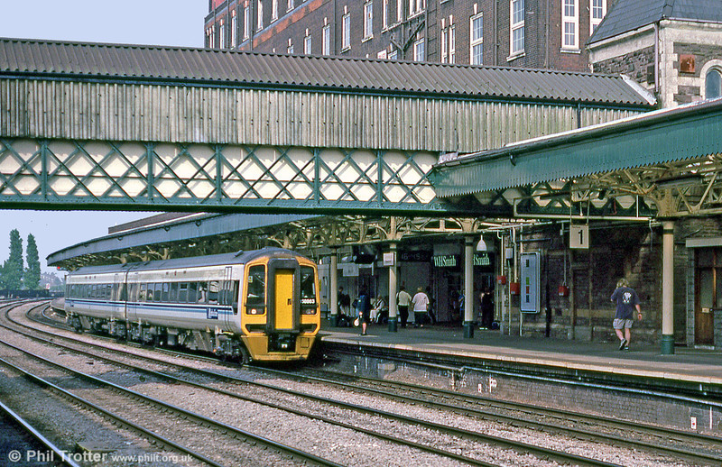 Alphaline 158863 calls at Newport with a service for Cardiff Central in September 2001.