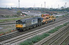 58041 'Ratcliffe Power Station' departs from Newport ADJ Yard with track maintenance equipment on 6th November 2000.