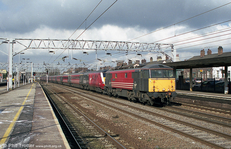 An unidentified class 87 heads through Stafford en route for London Euston on 2nd March 2001.