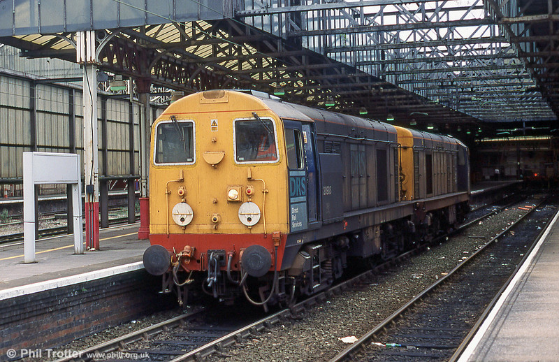 DRS class 20s headed by 20903 in the platforms at Crewe.
