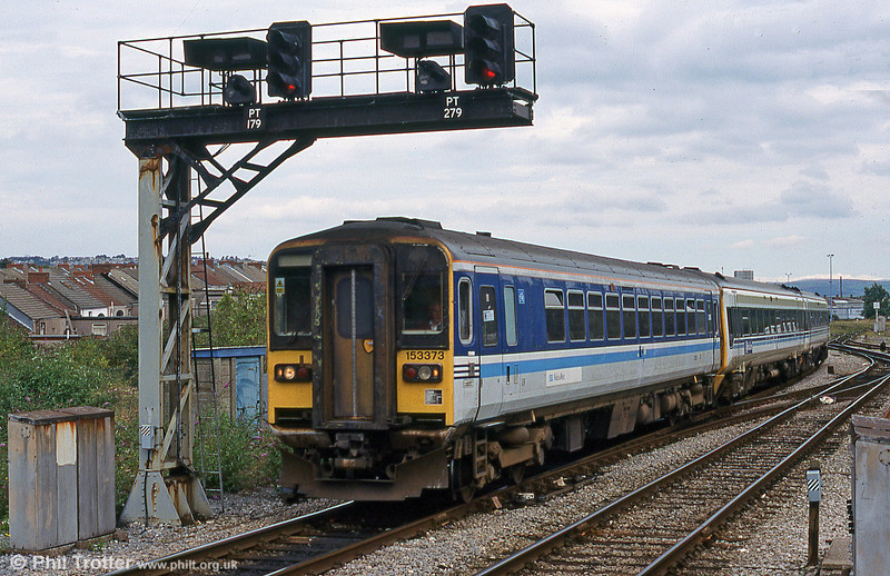 153373 with a temporary 'Wales & West' logo applied over the Regional Railways logo, arrives at Swansea in August 1999.