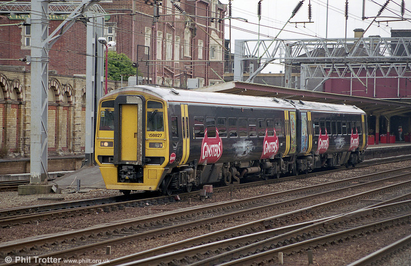 Ginster liveried 158827 at Crewe with a service for Manchester Piccadilly in August 2003.