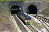 Central liveried 158859 emerges from Newport Tunnel at Gaer Junction on 27th March 2002.