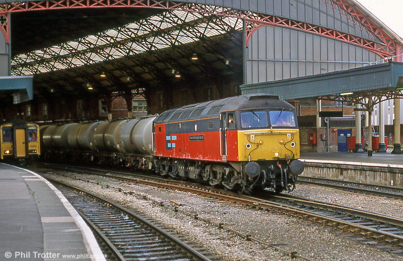 It's September 2001 and 47727 'Duke of Edinburgh's Award' passes through Bristol Temple Meads with the St. Phillips Marsh fuel tankers.