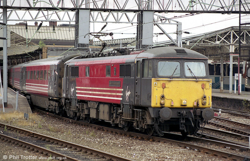 87011 'City of Wolverhampton' heads out of Crewe in August 2003. This loco was cut up at EMR Kingsbury in January 2011.
